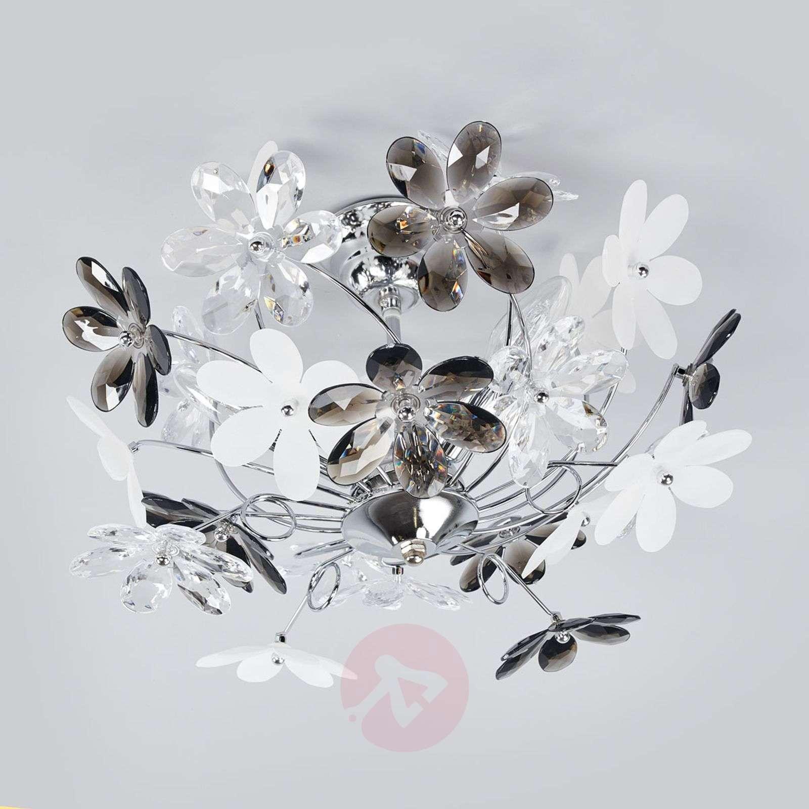 Flower-kattovalaisin läpinäkyvillä kukilla