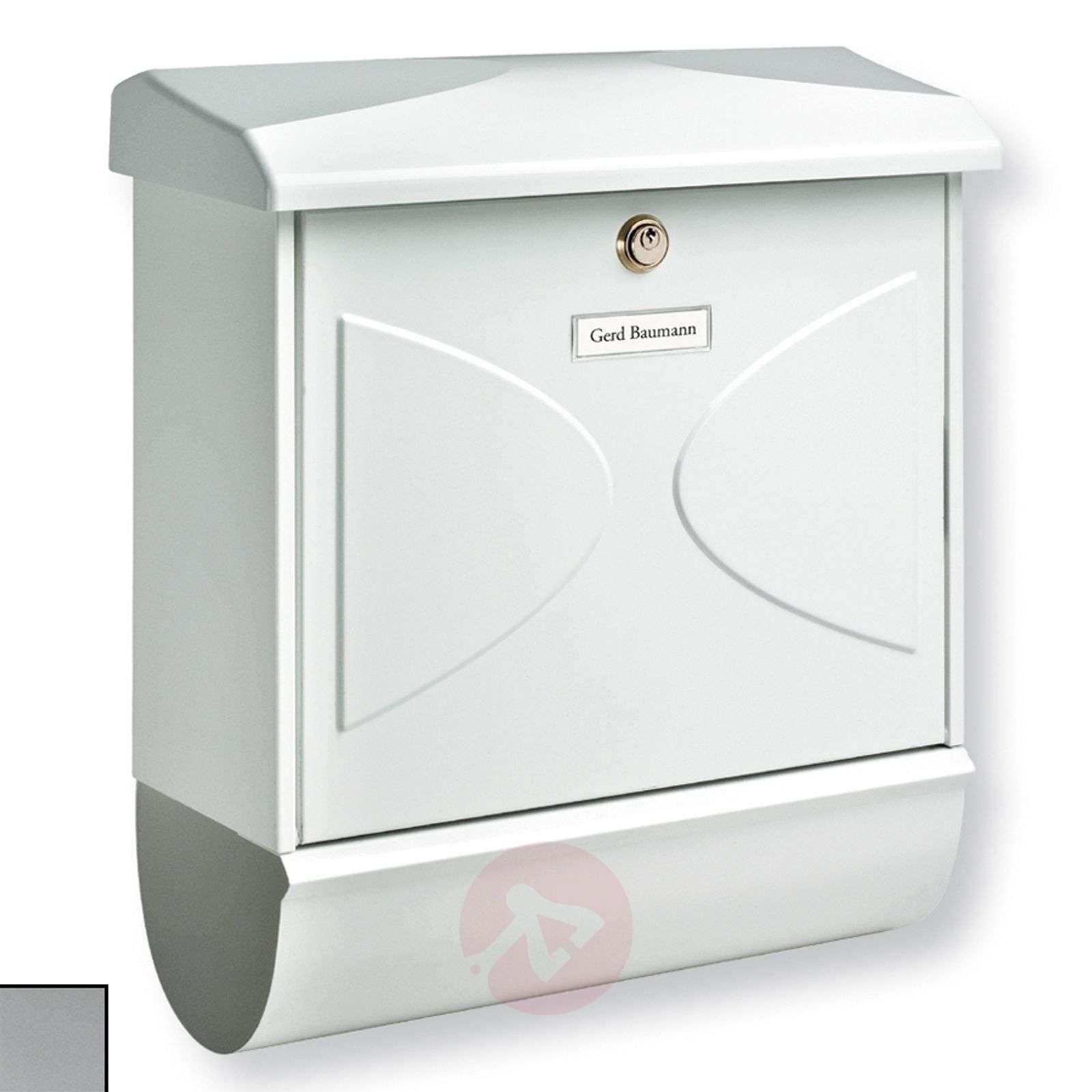 Futura postilaatikko sanomalehtirullalla-1532079X-01
